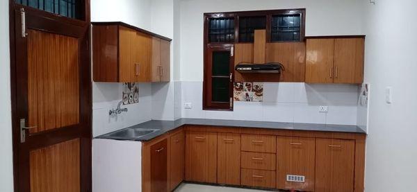 Modular kitchen with chimney in 2bhk flat bareilly